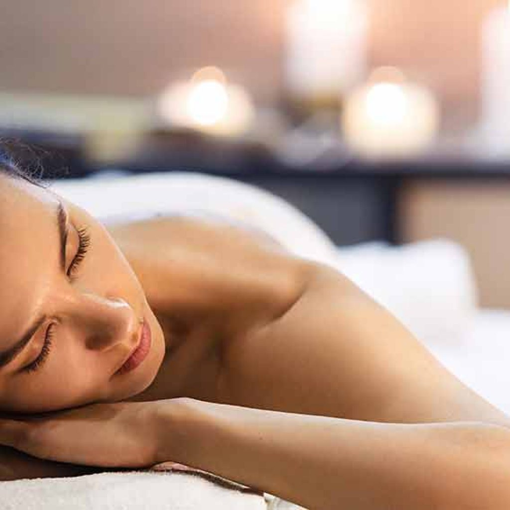 woman laying on a spa bed