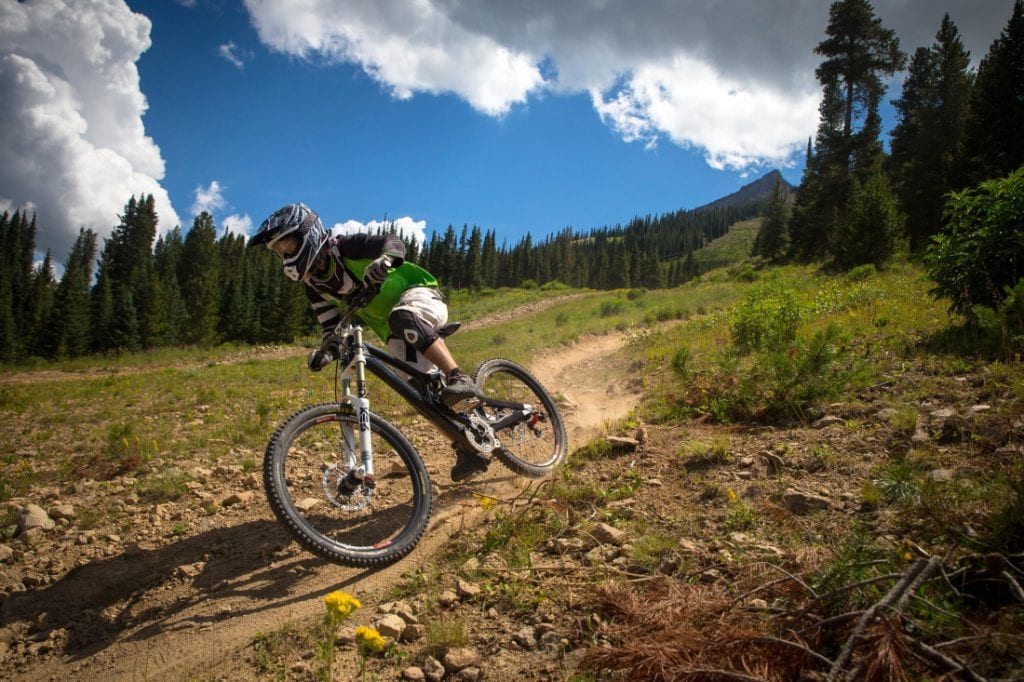mountain biker going down a dirt trail