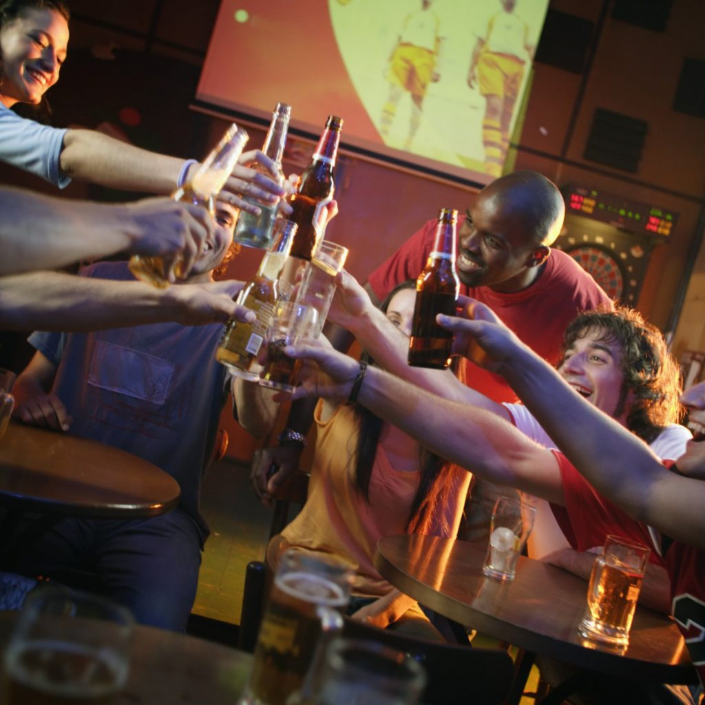 friends toasting at sports bar