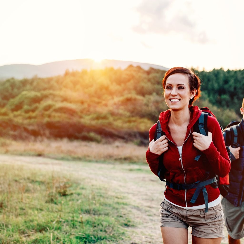 Smiling woman and man hiking