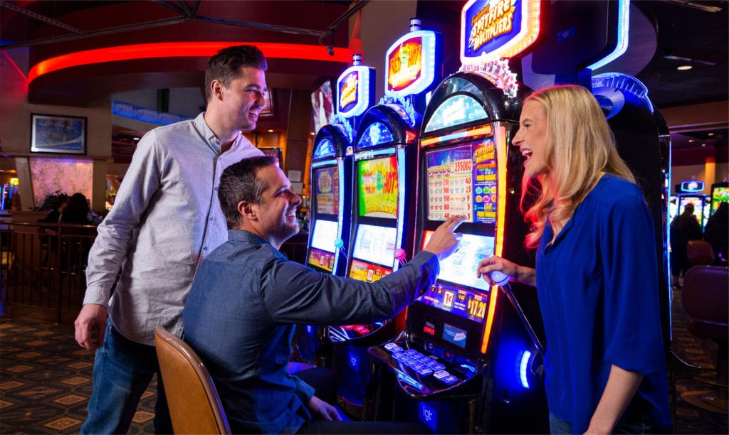 people playing slot machines at inn of the mountain gods